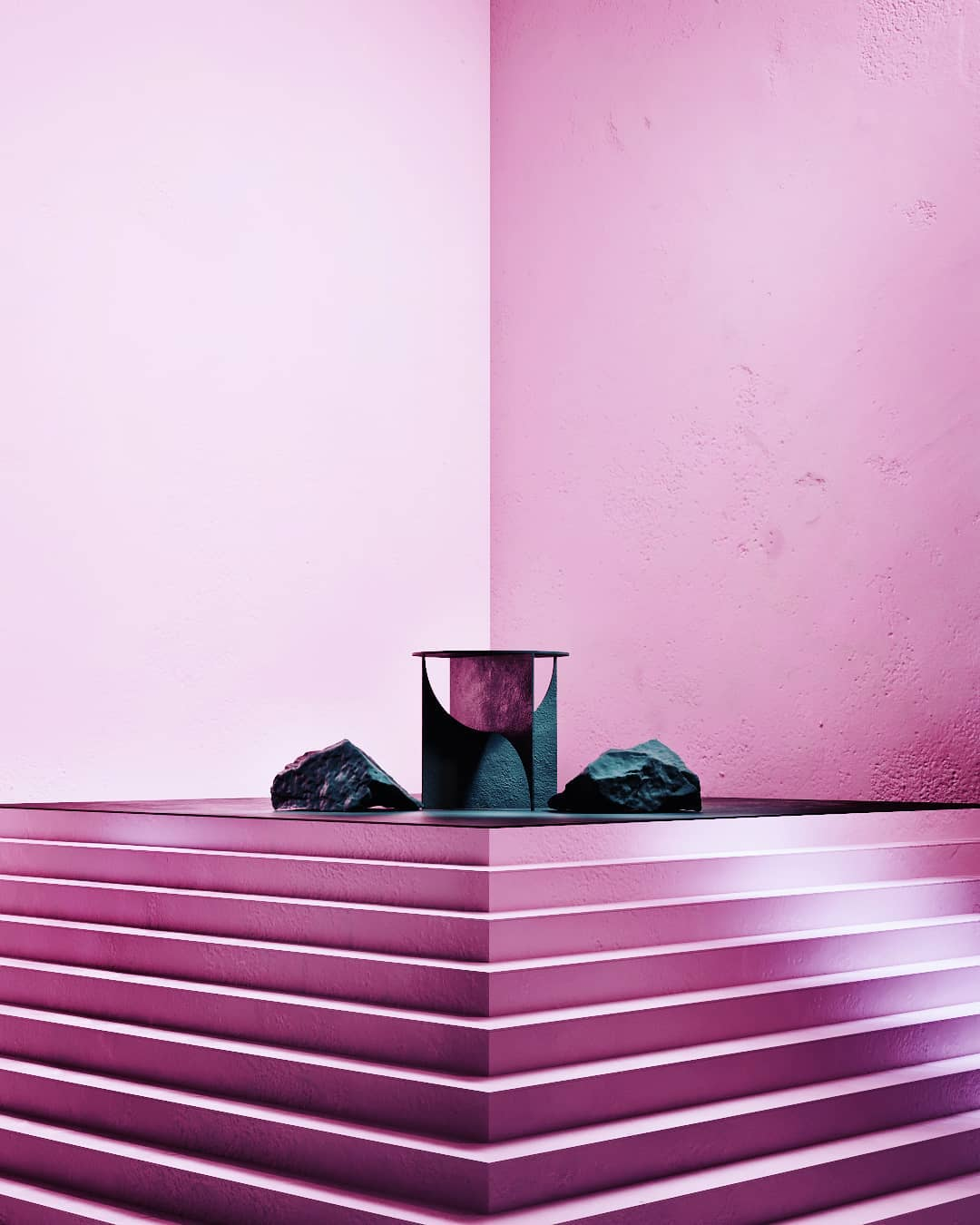 Pink space with a round metallic table and black rocks in the middle and a full length and width 90 degree stair design staircase leading up to the table and the stones