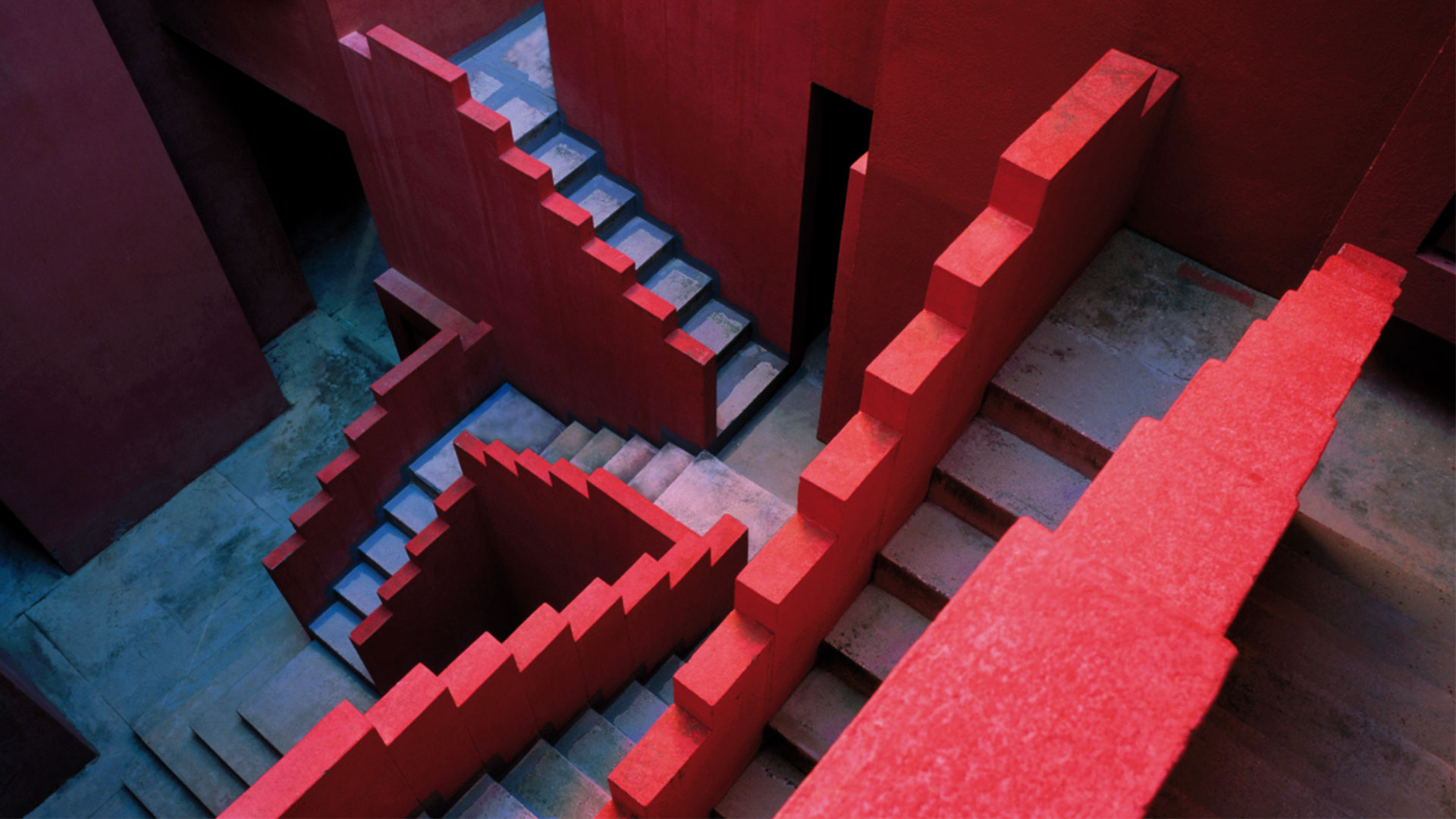 red and blue postmodern stair design seen in a dynamic perspective looking down